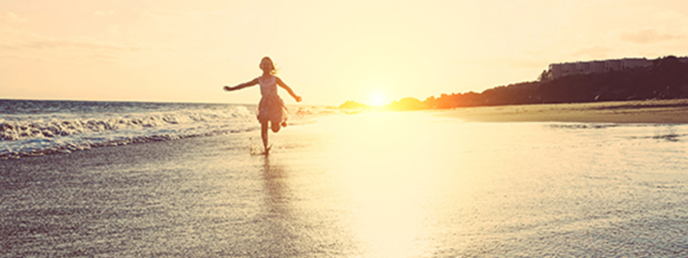 Picture of a child running on the beach